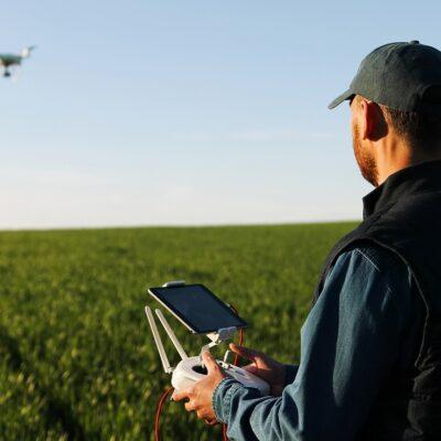 Farmer flying a drone